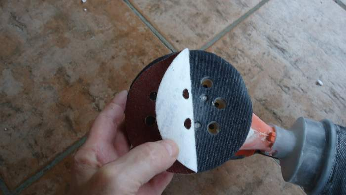 The sanding sheet attaches and removes easily.