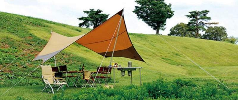 Quick shelter created with telescopic poles.